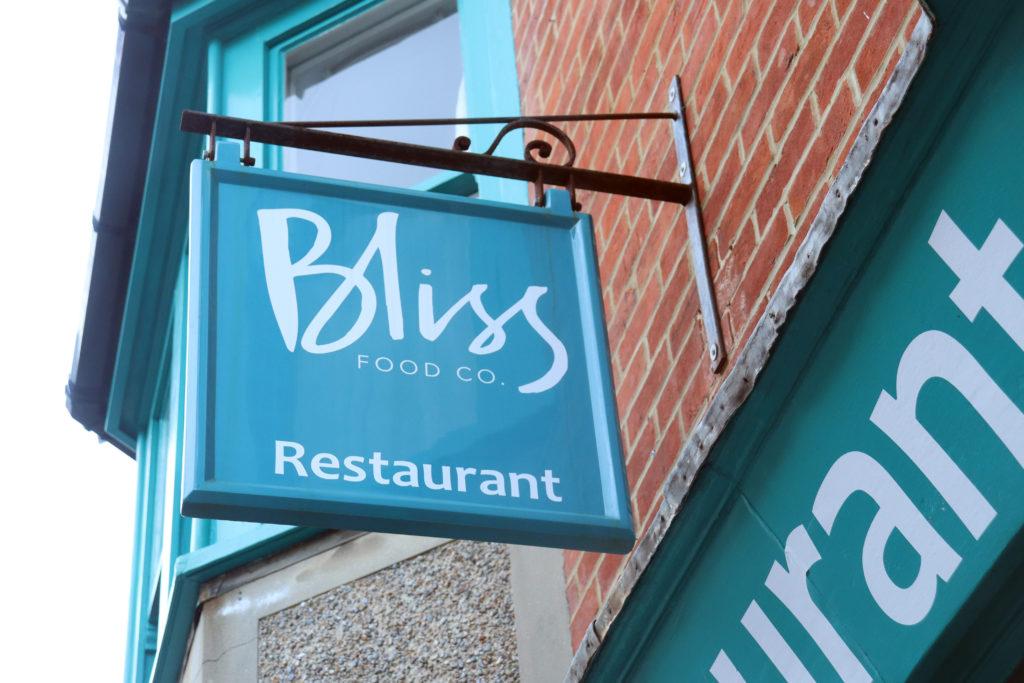 Sign hanging outside Bliss Restaurant