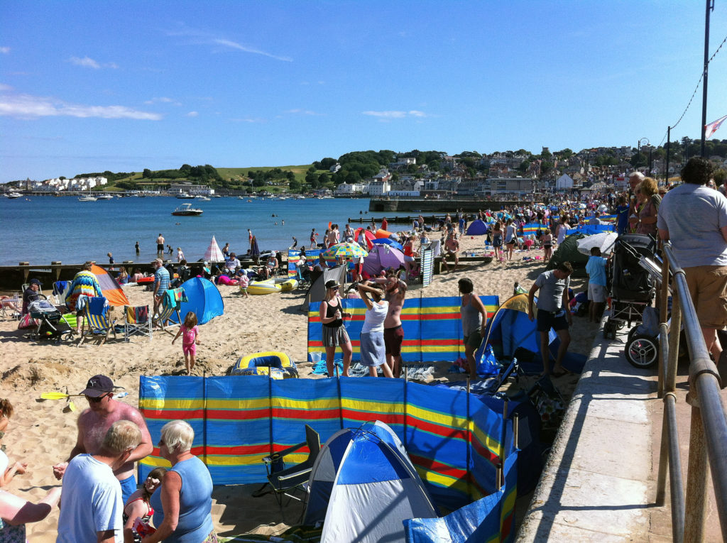 Lots of people on Swanage Beach in Carnival week