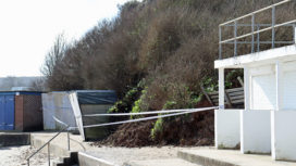 Beach huts damaged by landslip