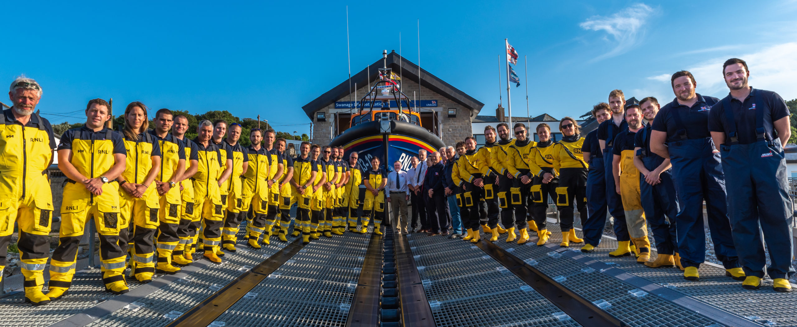 Swanage Lifeboat crew standing outside the Lifeboat house