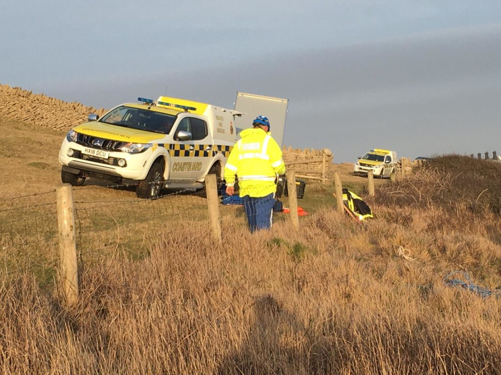 Swanage coastguard team rescuing climber at Anvil Point