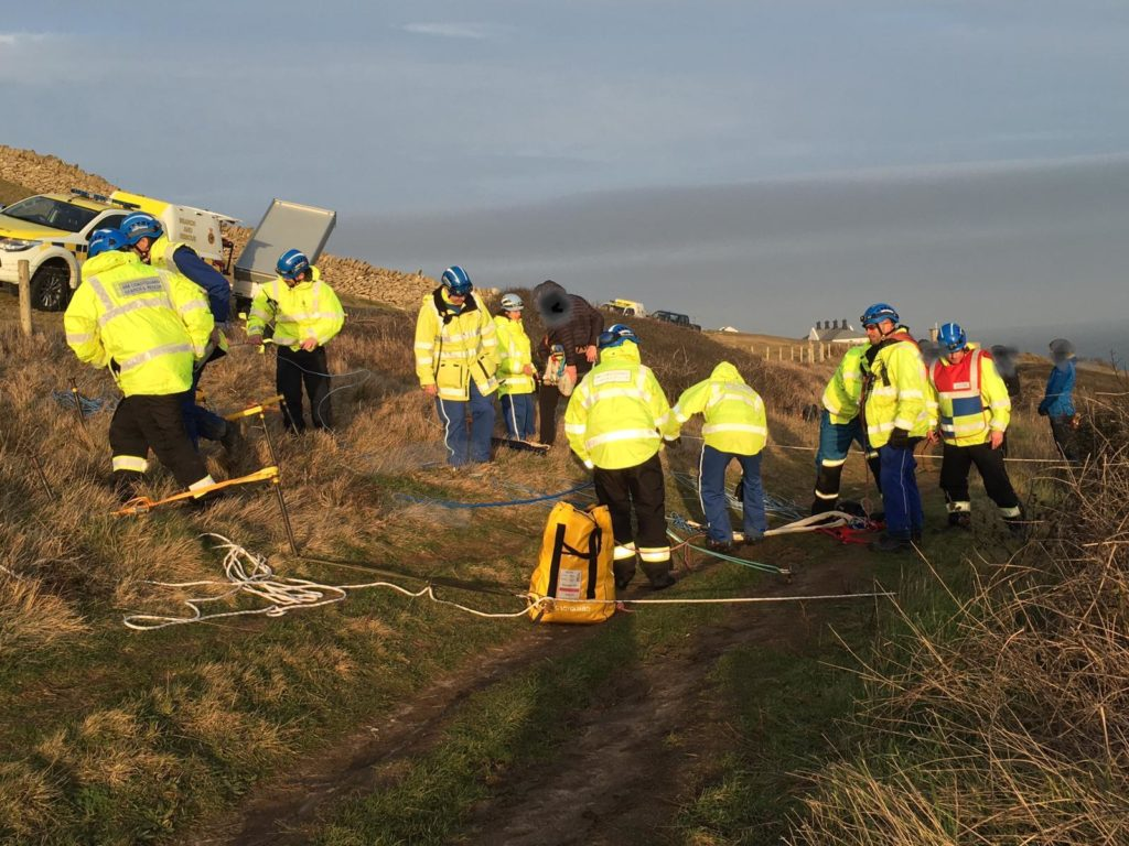 Coastguard teams rescuing climber at Anvil Point