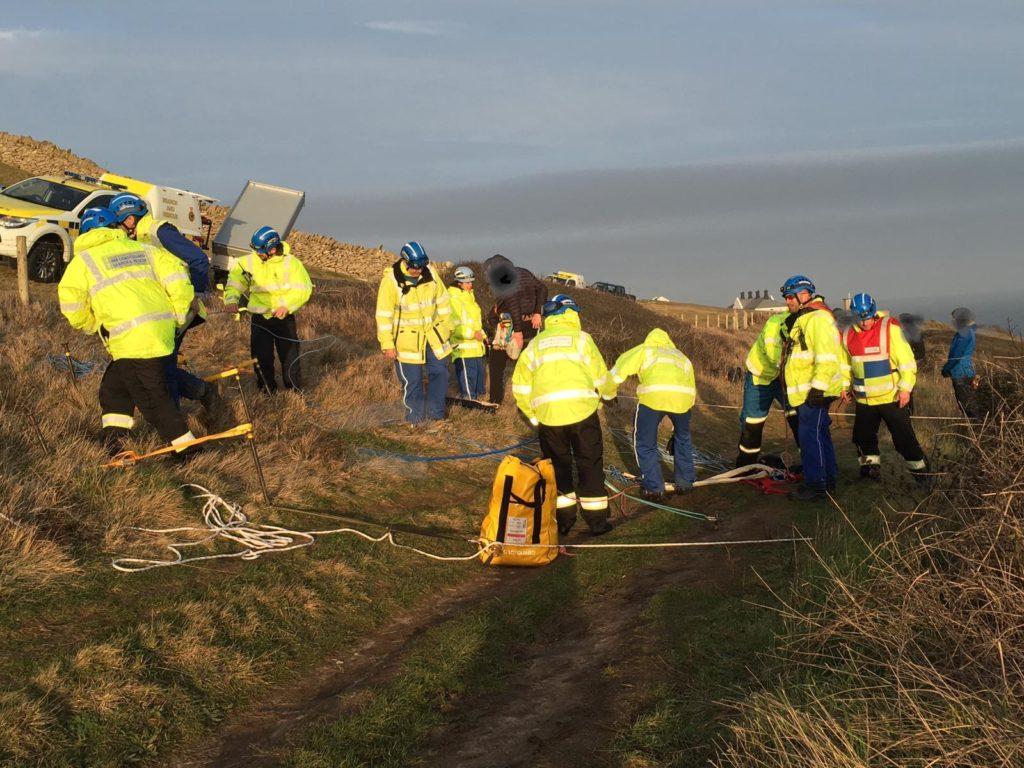 Coastguard teams rescuing climber at Anvil Point