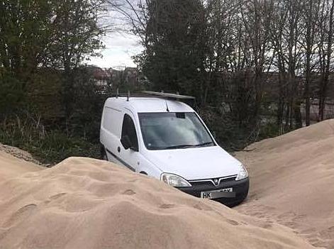 Van stuck in sand