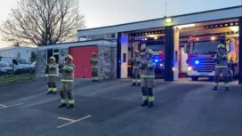 Swanage Firefighters standing outside the fire station