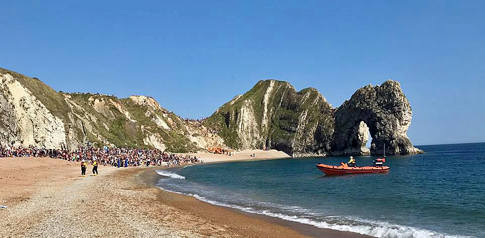 RNLI lifeboat and rescue helicopter at Durdle Door