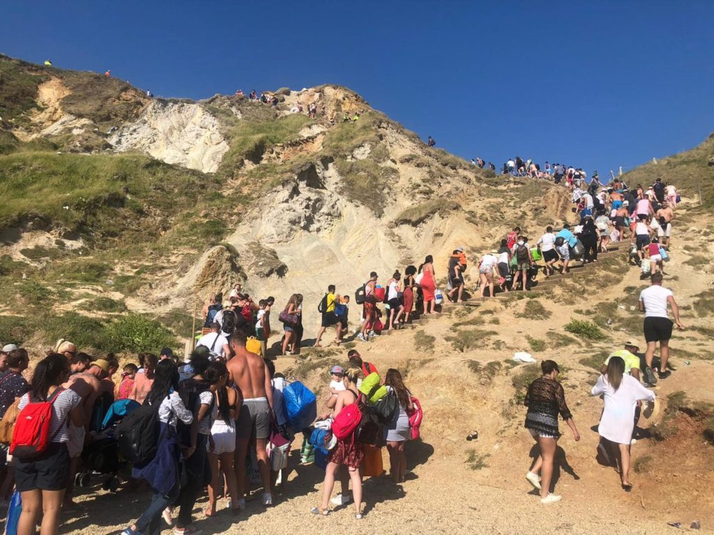 People queing as they are evacuated from Durdle Door