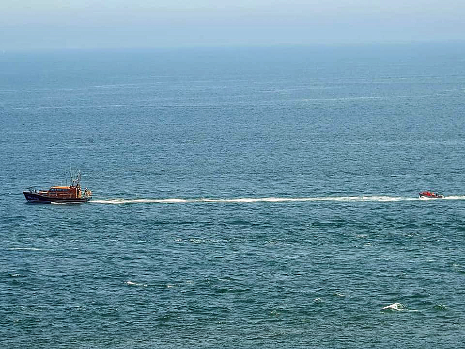 Swanage Lifeboat towing an angling boat