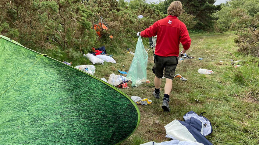 Camping gear and rubbish dumped in Studland