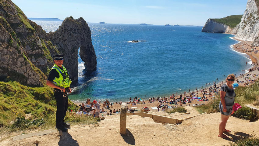 People on Durdle Door despite its closure