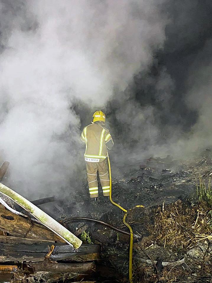 Firefighters fight farmyard fire