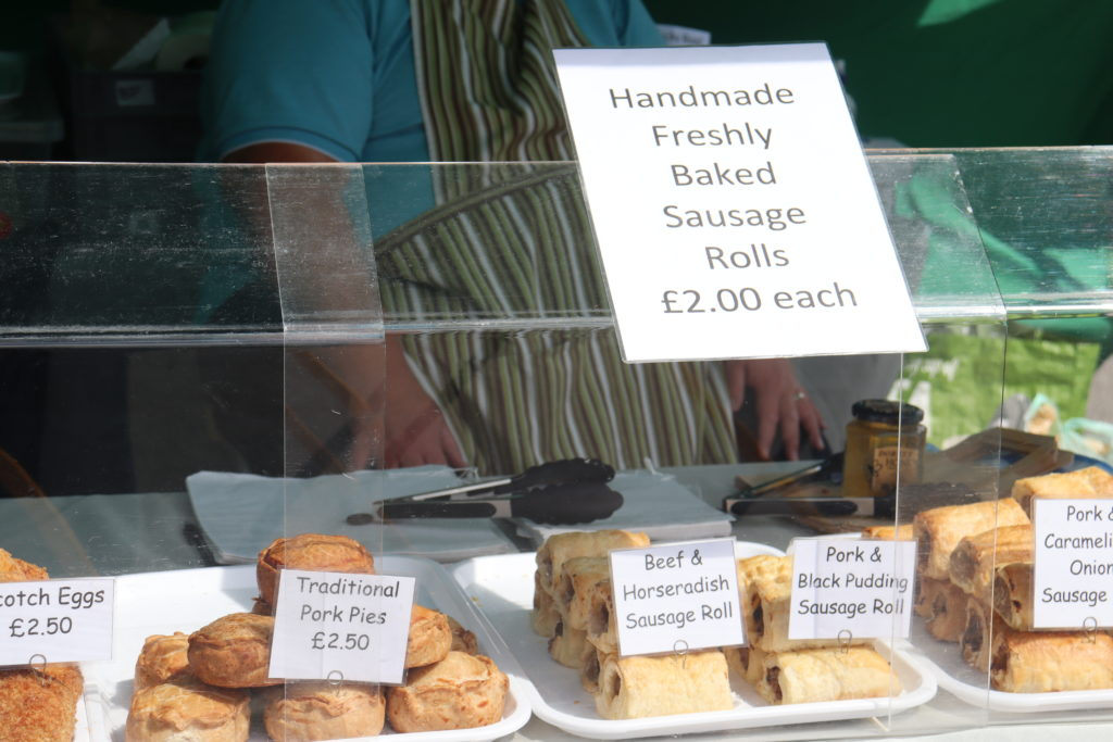 The Deli stall at Swanage Market with sausage rolls