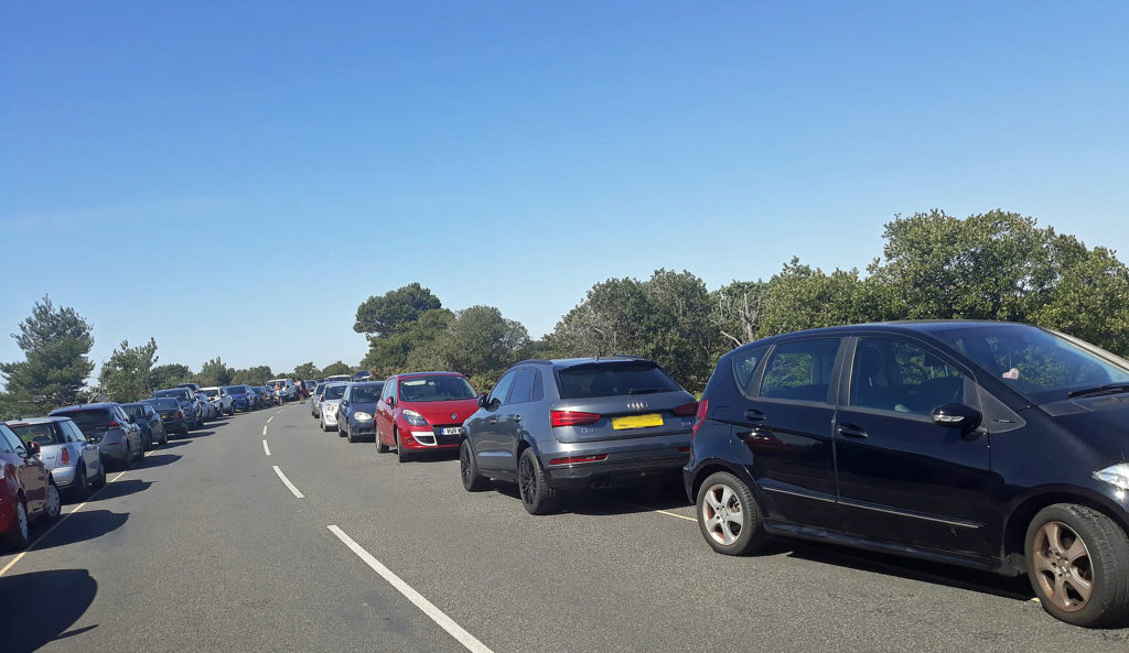 Vehicles parked on Ferry Road in Studland
