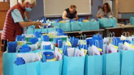 Bags being filled with art supplies for children