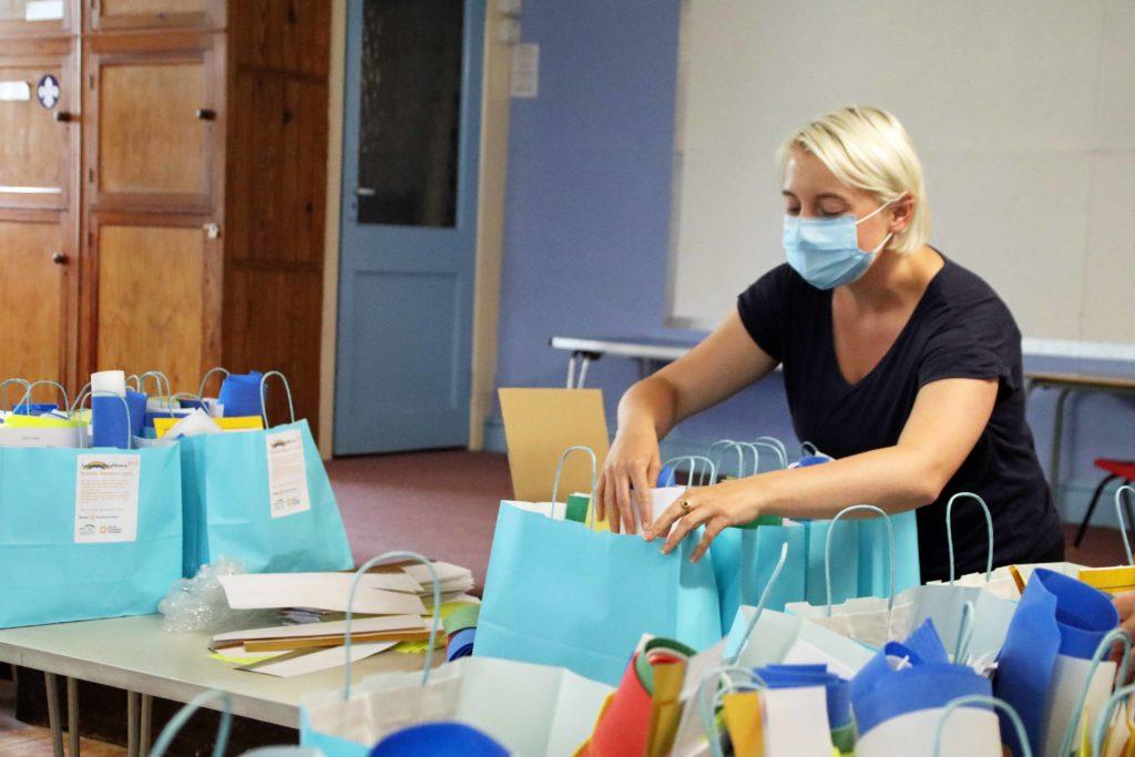 Laura Rowan filling the art bags