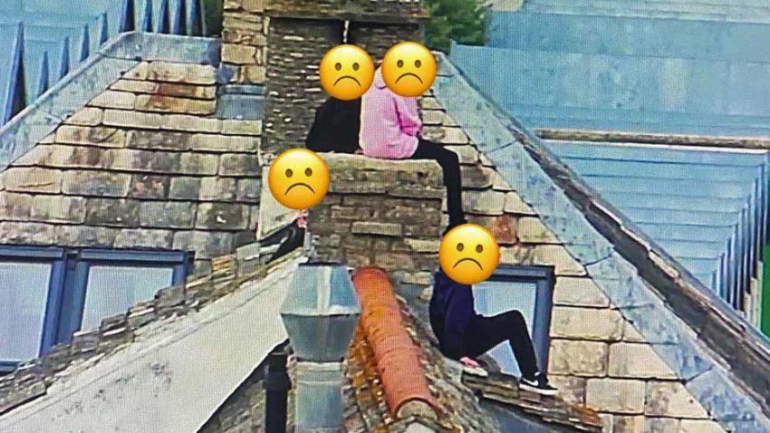 Children sitting on roof