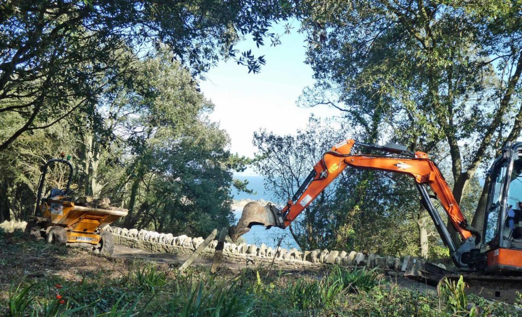 A digger improves a path at Durlston country park