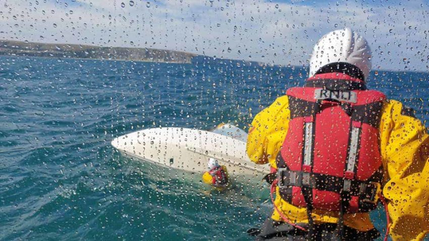 Swanage Lifeboat rescues a capsized boat