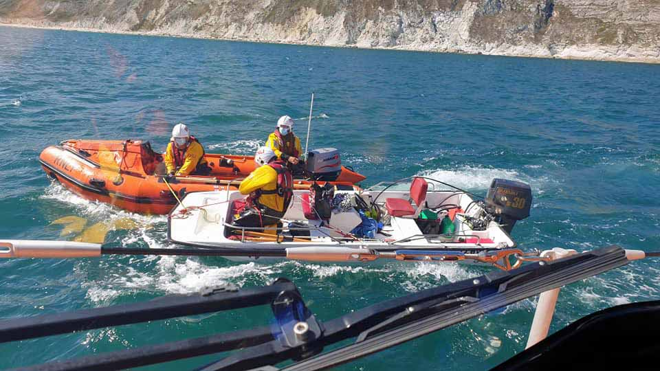 Swanage Lifeboat crew rescuing boat