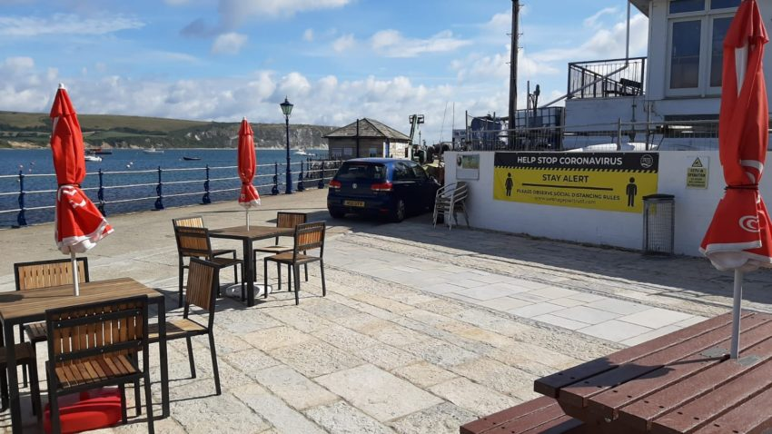 Swanage Pier with socially distanced tables