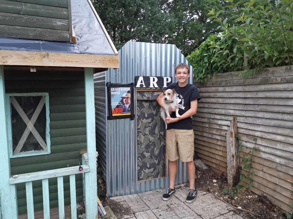 Ben outside his air raid shelter with his dog