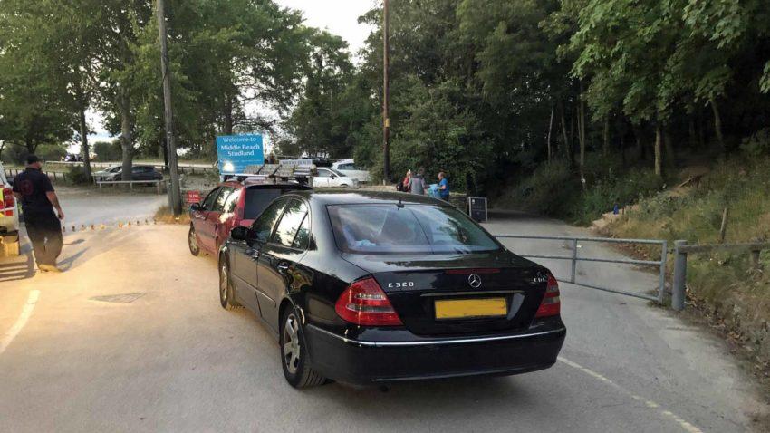 Car blocking Studland beach emergency access