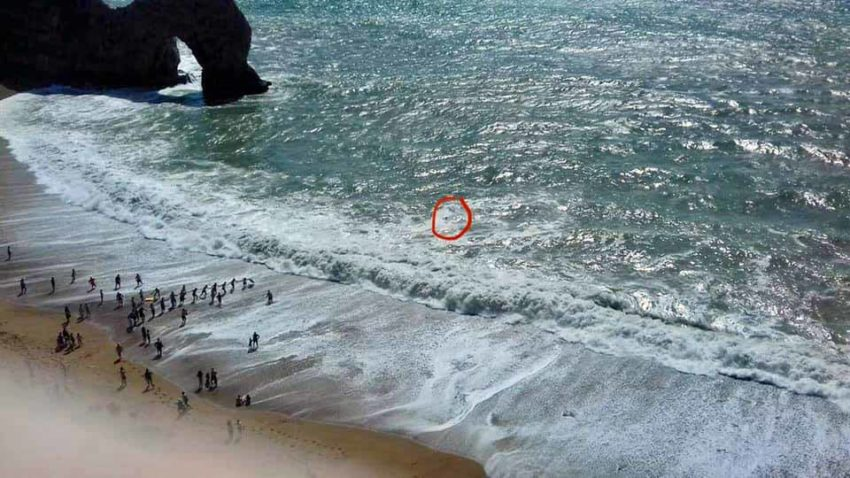 A man rescued by human chain at Durdle Door