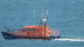 Lifeboat towing a yacht