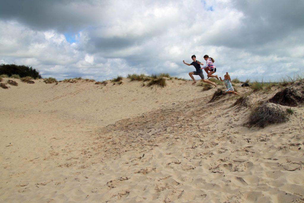 Children playing at Studland dunes