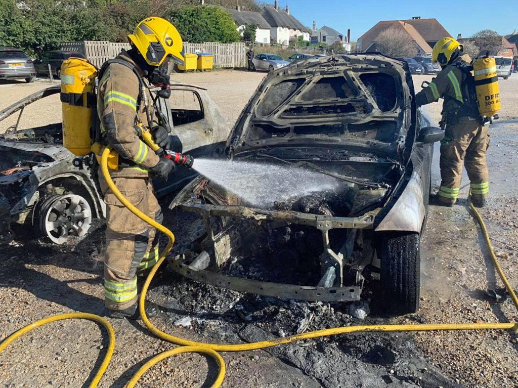 Burnt out cars at Lulworth car park