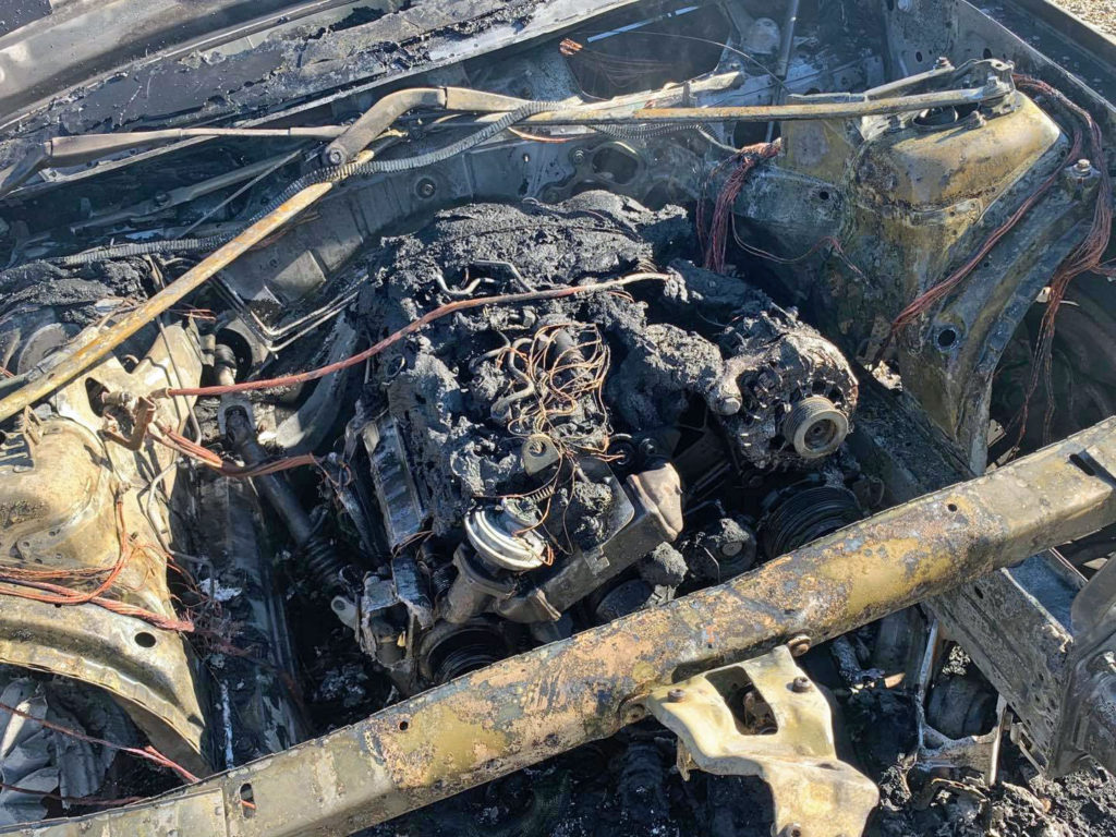 Burnt out engine at Lulworth car park