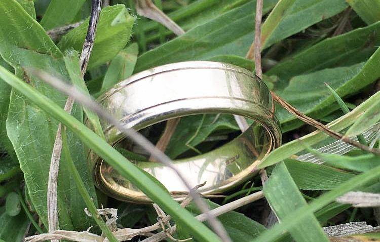 Wedding ring found in grass