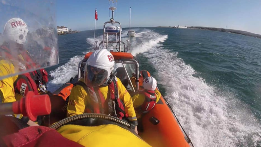 Poole lifeboat rescuing a yacht