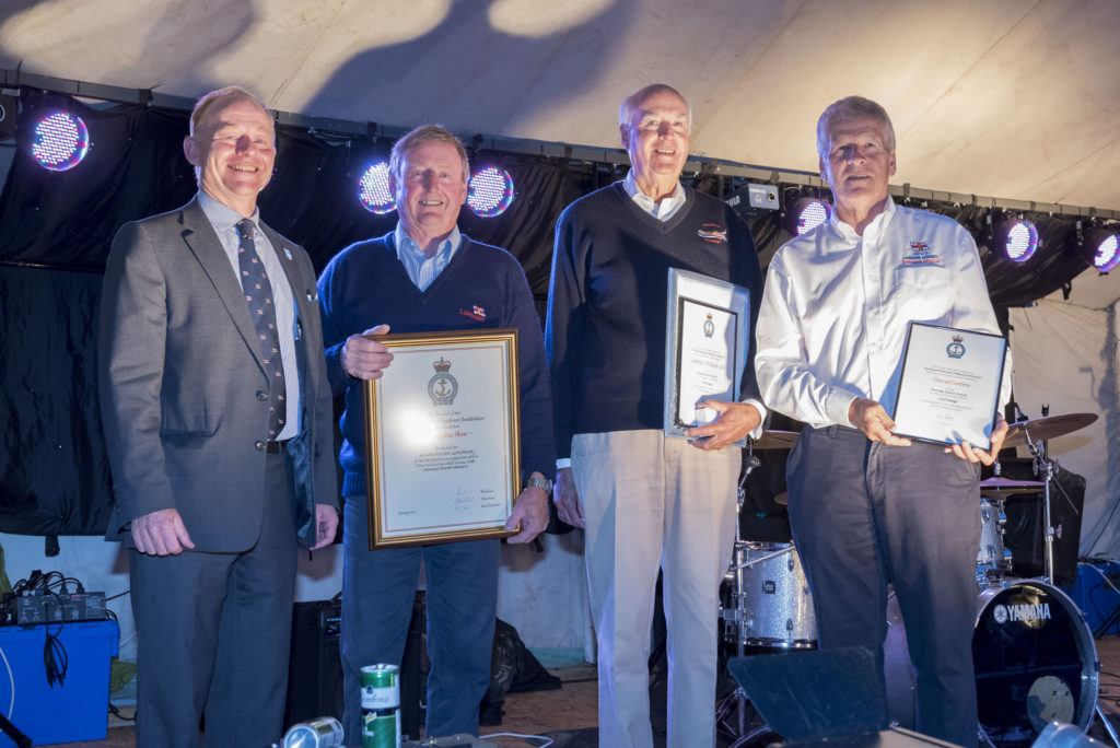 Chris Haw, Charles Buckle and Dave Corben presented with awards at Swanage lifeboat week