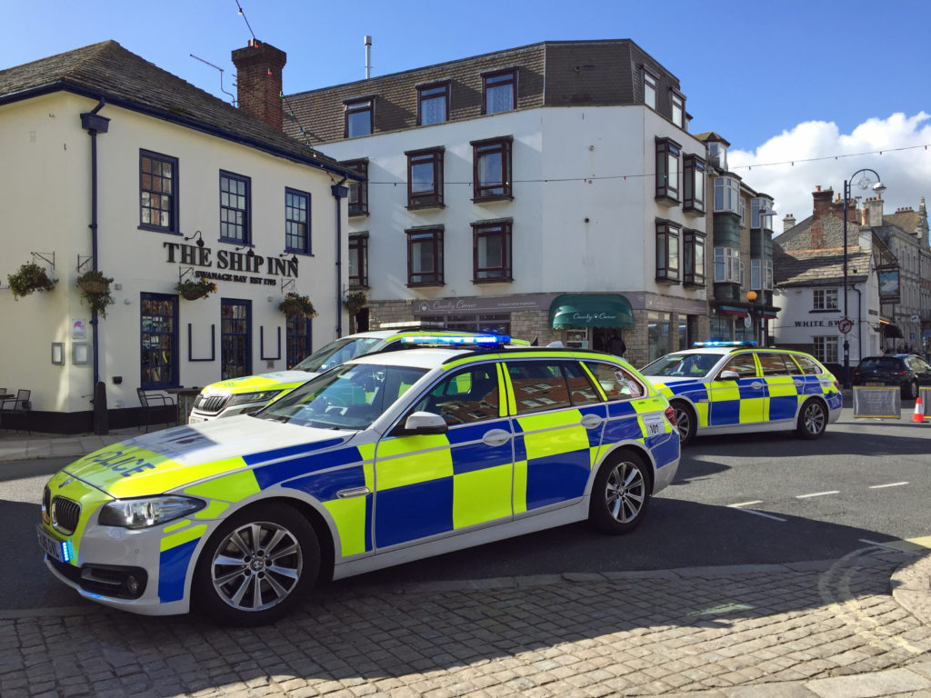 Police cars in High Street