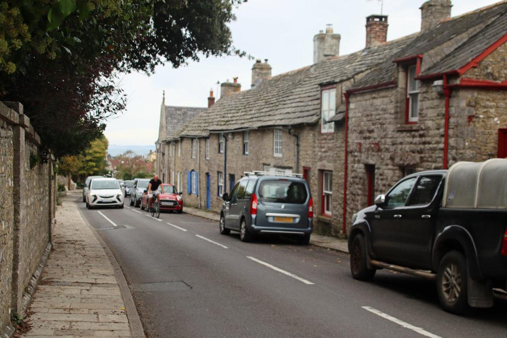 Cyclist in Langton Matravers high street
