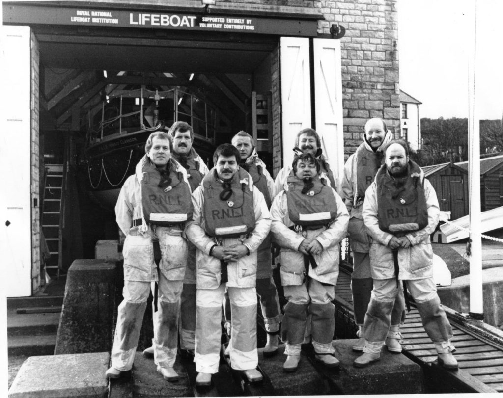 Lifeboat crew outside the old Swanage Lifeboat Station