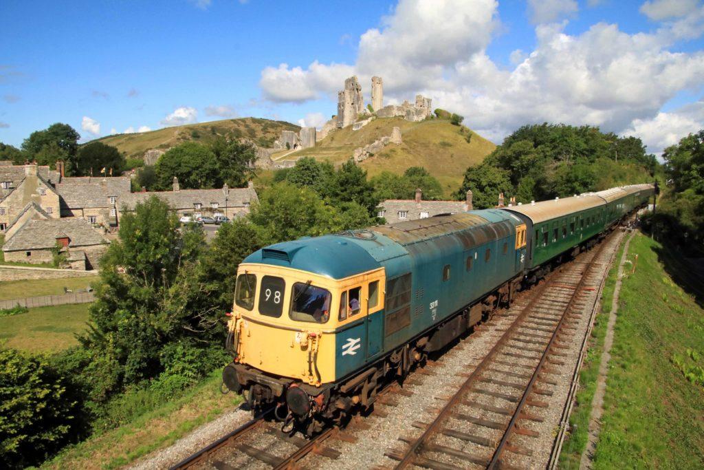 Diesel train going past Corfe Castle