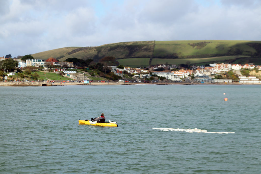 The Disappearing Fish installation towed across Swanage Bay