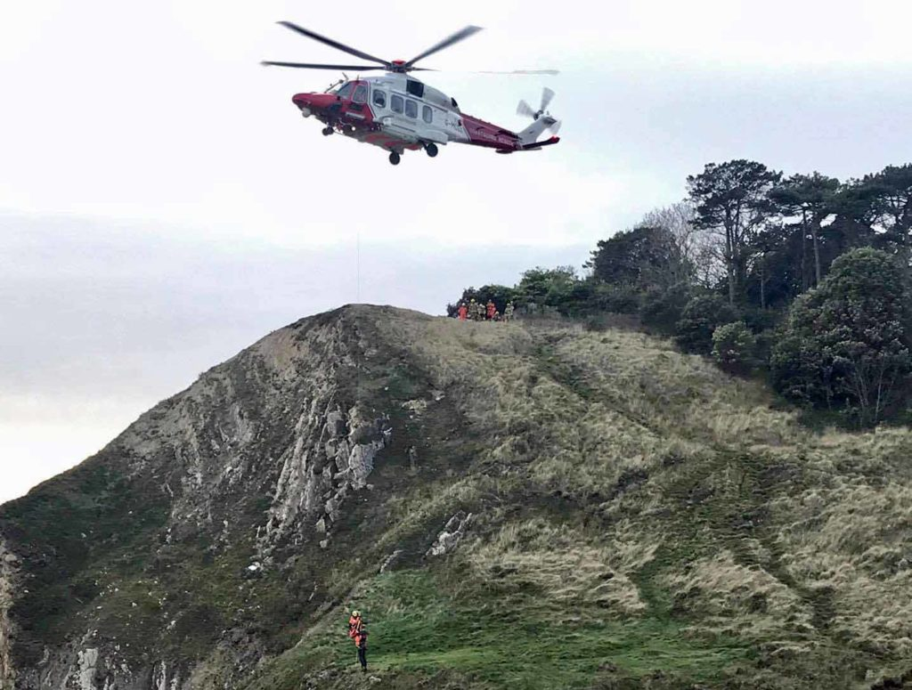 Climber being rescued by helicopter at Lulworth