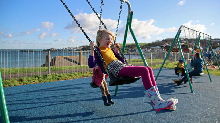 Girl on a swing in playground
