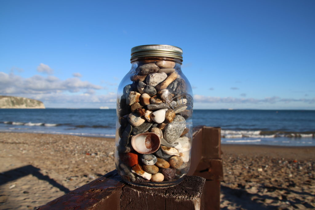 Jar filled with pebbles and shells
