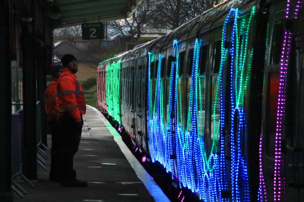 Lights being added by crew to train at Swanage Station