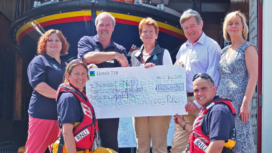 Swanage Lifeboat Station chairman, Peter Foster accepting a cheque