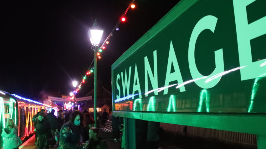 Swanage sign at Swanage station with festive lights