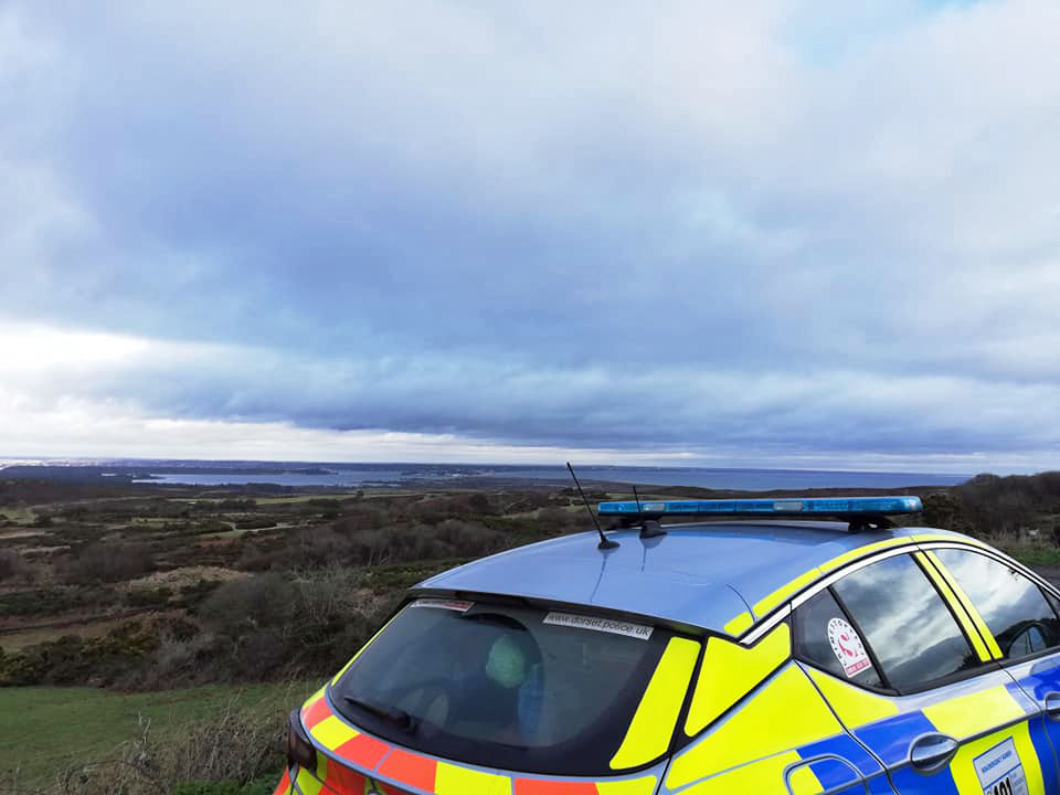 Purbeck police on patrol looking over Poole Harbour