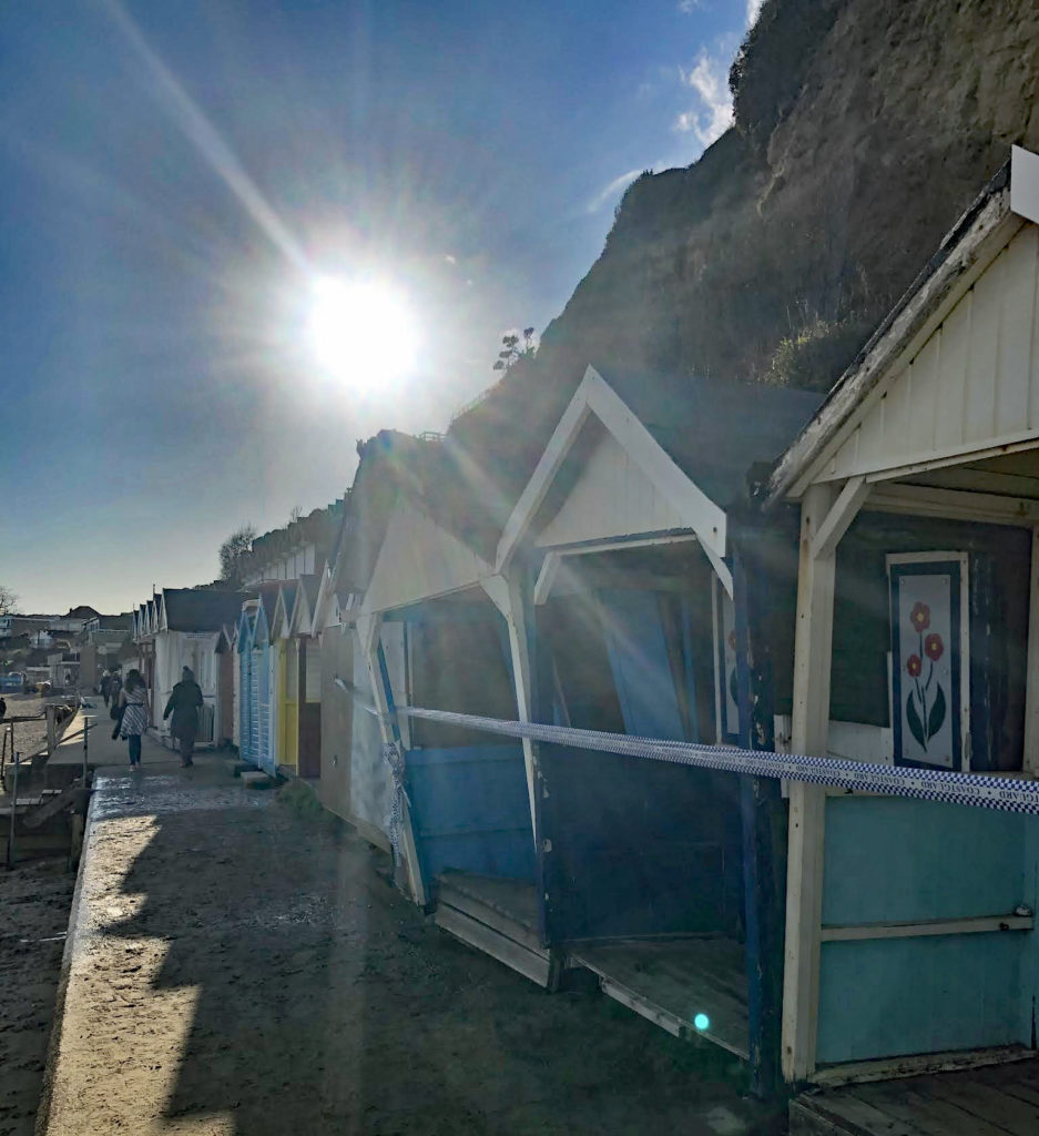 Beach huts affected by landslip near Sheps Hollow