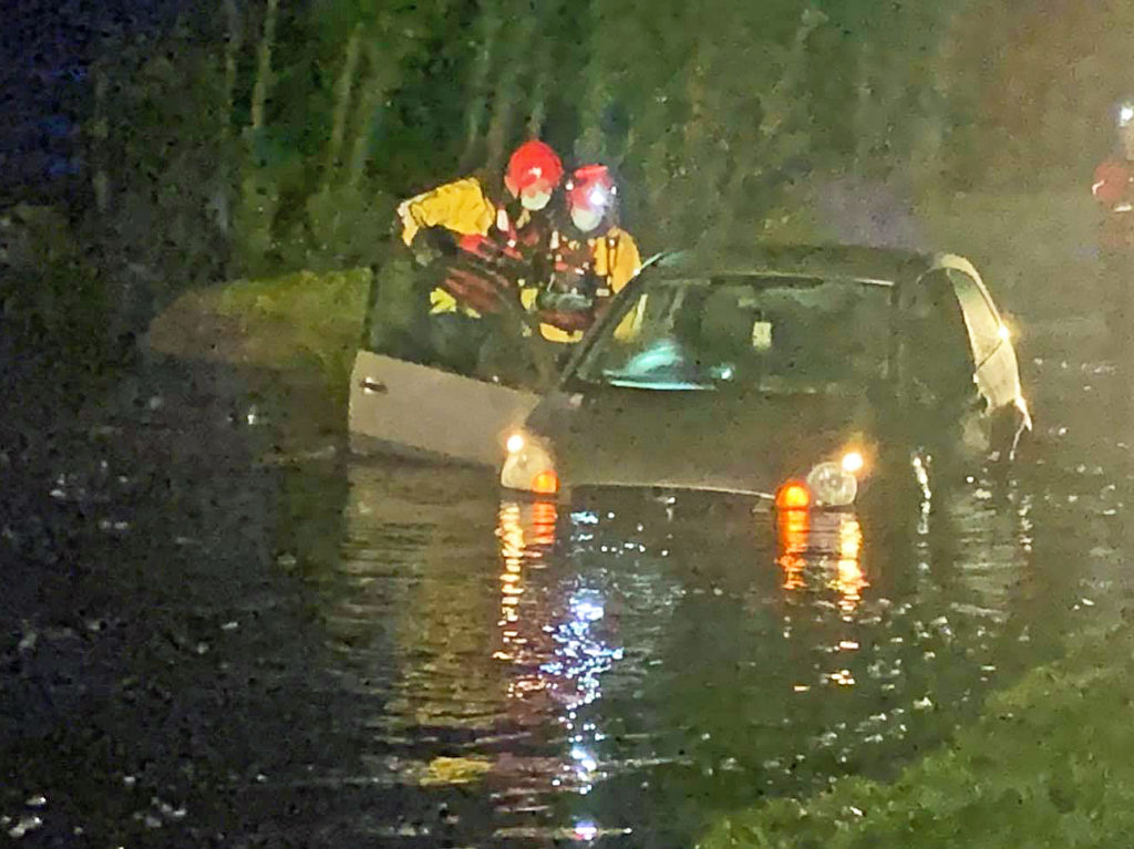Car stuck in flood at East Holme