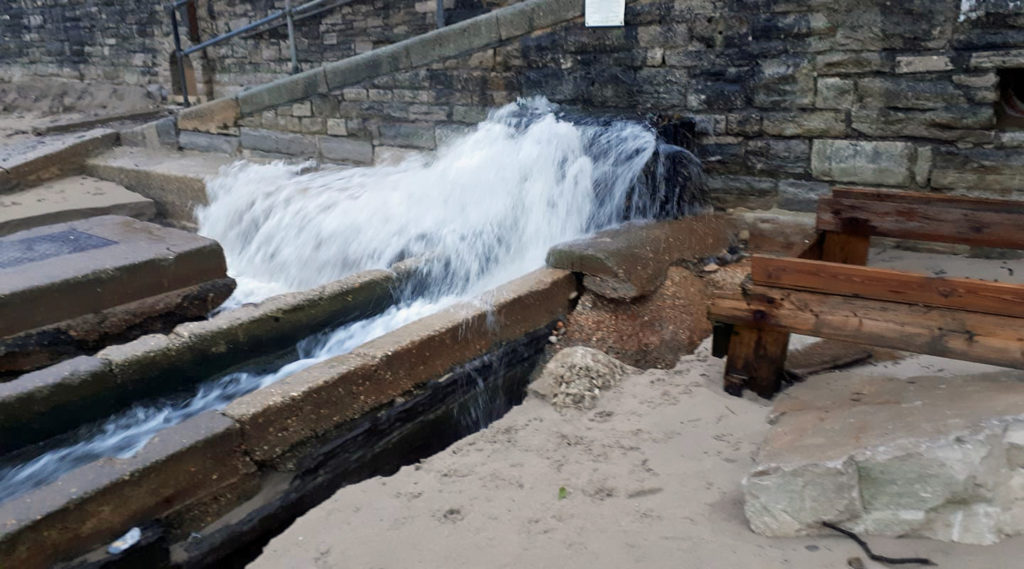 Overflowing water outlet at Ocean Bay in Swanage