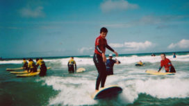 Young people on surf boards